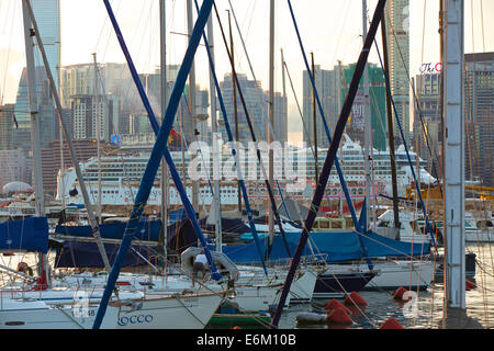 Cruise Ship Steaming Through Victoria Harbour. Viewed Through The Mast Of Boats Moored In The Causeway Bay Typhoon - Stock Photo