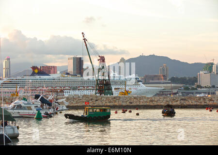 Cruise Ship Steaming Through Victoria Harbour. Causeway Bay, Hong Kong. - Stock Photo
