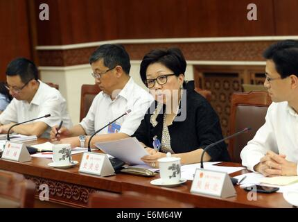 Beijing, China. 26th Aug, 2014. HKSAR's representative Laura Cha Shih May-lung (2nd R) speaks at the 10th meeting - Stock Photo