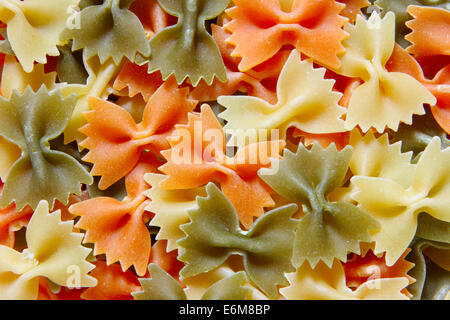 Bows - italian pasta, may be used as background - Stock Photo