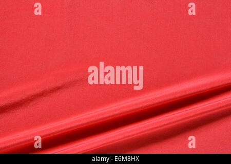Shiny red fabric background texture stock photo 27028600 for Red space fabric