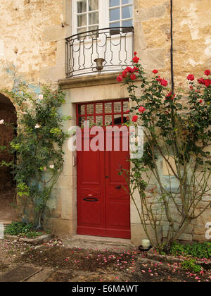 Red door in Baume les Messieurs, considered one of the most beautiful villages in France. Jura region. - Stock Photo