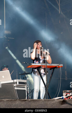 young female singer performing on one of the stages at the victorious festival 2014 southsea england uk - Stock Photo