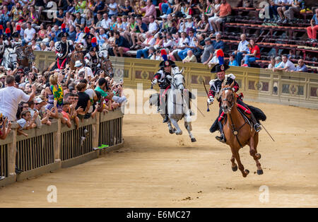 Cavalry charge by the carabinieri, Palio di Siena, historical parade, Siena, Tuscany, Italy - Stock Photo