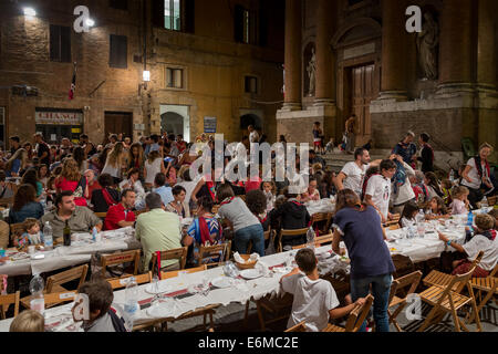 Civetta (little owl) contrada (district) meal before the Palio, Siena, Tuscany, Italy