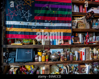 Book-case at the Red Rooster restaurant that is led by chef Marcus Samuelsson in Harlem New York city - Stock Photo