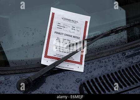 Parking ticket issued by Edinburgh City Council on a car windscreen. - Stock Photo