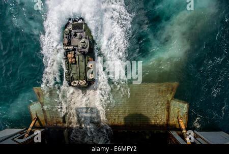 US Marines in an amphibious assault vehicle exit the well deck of the amphibious assault ship USS Bataan during - Stock Photo