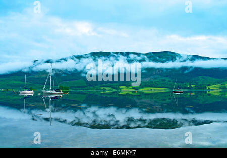 Early morning mist clings to hillside near North Ballachulish, seen across Loch Leven from Glencoe, Lochaber, Highlands - Stock Photo
