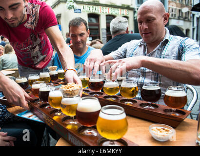 Beer tasting in one of the vibrant bars in the historical center of Brussels. - Stock Photo