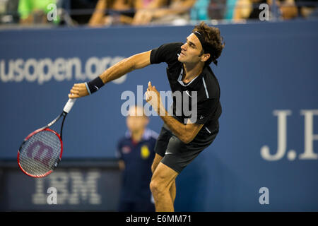 Flushing Meadows, NY, USA. 26th Aug, 2014. Roger Federer (SUI) in first round action during Day 2 of the US Open - Stock Photo