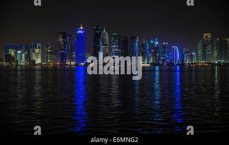 Night scene of the skyline of Doha with Al Bidda Tower, World Trade Center, Palm Tower 1 and 2, Burj Qatar Tower, - Stock Photo