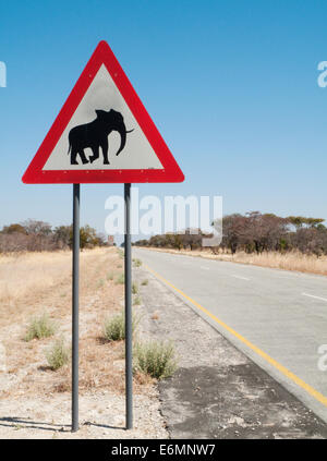 Traffic sign warning of crossing elephants at the B8 at its section through the Bwabwata National Park in the Caprivi - Stock Photo