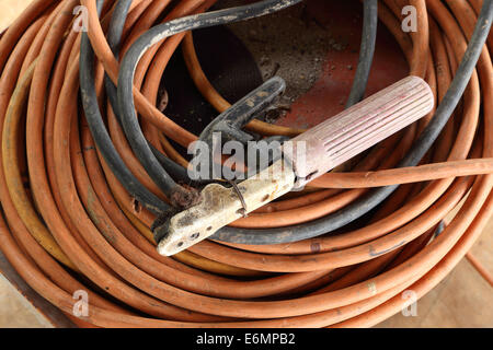 Welding electrode holder with attached electrode wire - Stock Photo