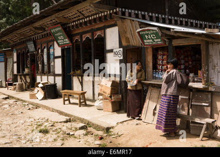 Eastern Bhutan, Trashigang, Kanglung, people shopping at General Stores in lower market - Stock Photo