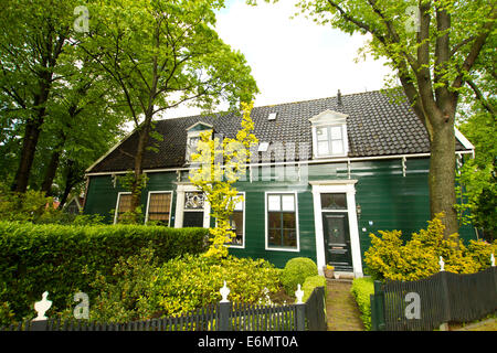 rural dutch scenery of small old houses and canal in Zaanse, Netherlands - Stock Photo