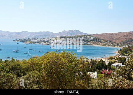 View over the bay looking out onto the boats and clear blue sea of Beyaz Beach Club, Bitez, Bodrum, Turkey - Stock Photo