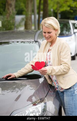 Female car driver gets a love letter - Stock Photo