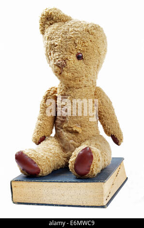 antique teddy bear and book - Stock Photo