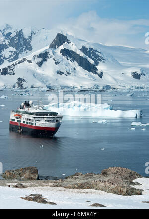 tourist ship that stands in the strait near the penguin colony - Stock Photo