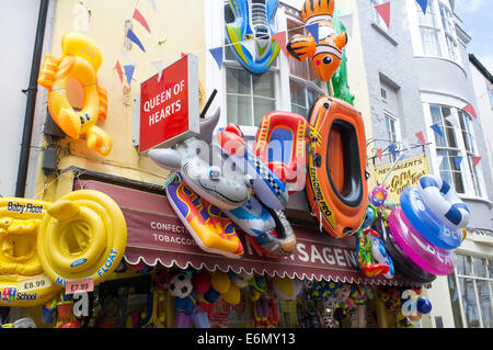 Seaside beach inflatable toys hanging outside of a shop in Weymouth Dorset UK - Stock Photo