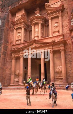 Camels In Front Of The Treasury, Petra, Jordan, Middle East - Stock Photo