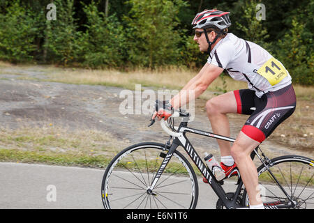 Individual Millennial man wearing Lycra racing in a bike cycle race organised by British Cycling at Fowlmead Country - Stock Photo