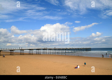 Summer skies sandy beach and  Pier of the Year 2009  Saltburn-by-the-Sea Cleveland England UK - Stock Photo