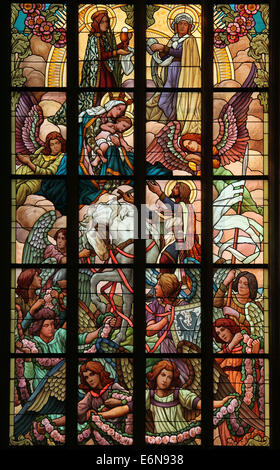 Saint Wenceslas and the Virgin Mary. Stained glass window in Saint Barbara's Church in Kutna Hora, Czech Republic. - Stock Photo