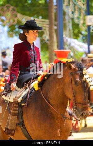 Girl on Horse in Traditional Spanish Costume, Annual Horse Fair, Jerez de la Frontera, Cadiz Province, Andalusia, - Stock Photo