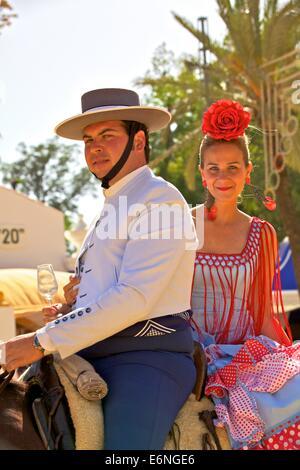 Spanish Horse Riders in Traditional Dress,  Annual Horse Fair, Jerez de la Frontera, Cadiz Province, Andalusia, - Stock Photo