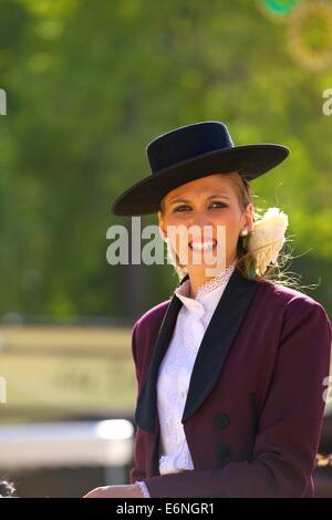 Woman  in Traditional Spanish Costume, Annual Horse Fair, Jerez de la Frontera, Cadiz Province, Andalusia, Spain - Stock Photo