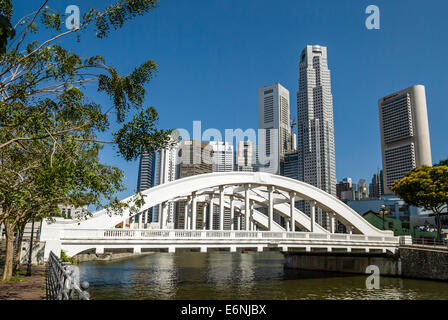 Elgin Bridge is a vehicular bridge across the Singapore River in downtown Singapore, with the skyline in the background. - Stock Photo