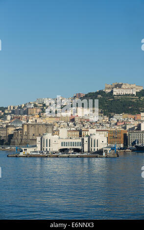 The main harbour and docks for ferries and cruise ships at Naples in Italy. - Stock Photo