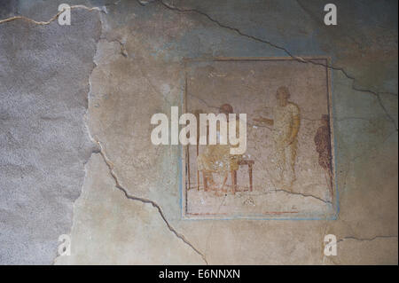 Internal wall drawings or paintings in the ruined city of Pompeii. - Stock Photo