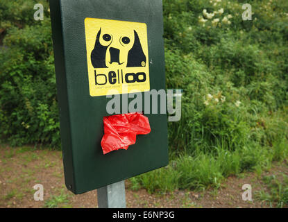 A box with plastic bags for dog dirt is seen near Altglashuetten in the Black Forest, July 29, 2014. Photo: Wolfram - Stock Photo