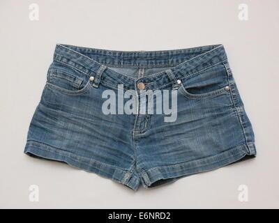 Pair of blue female shorts isolated against white background - Stock Photo