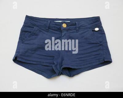 Pair of female shorts isolated against white background - Stock Photo