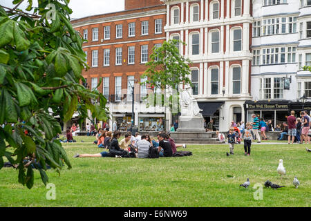 Cathedral yard in summer with people enjoying good summer weather, Exeter, Devon, England, UK - Stock Photo