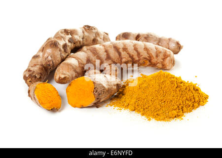 Heap of ground turmeric and turmeric roots on white background