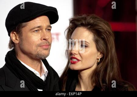 US actress Angelina Jolie poses on the red carpet with her fiance and actor Brad Pitt at the premiere of the movie - Stock Photo