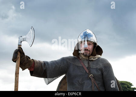 Viking wearing armor and carrying an axe at a historical reenactment. UK - Stock Photo