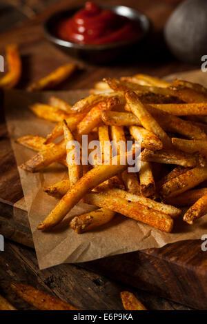 Cajun Seasoned French Fries with Organic Ketchup - Stock Photo