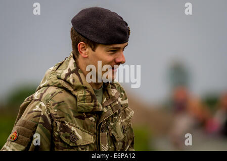 Portrait of a Royal Logistics Corps bomb disposal ammunition technician person attending a British beach WWII bomb - Stock Photo