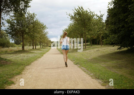 female jogger seen from behind - Stock Photo