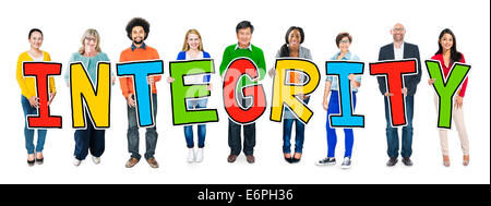 Group of People Standing Holding Integrity Letter - Stock Photo