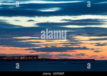 Sunrise over The Headland at Hartlepool from Seaton Carew beach. England, UK - Stock Photo