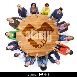 Multiethnic People Holding Hands with Handshake Symbol - Stock Photo