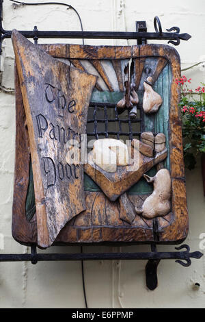 The Pantry Door. Carved shop sign in Church Street, Whitby. - Stock Photo