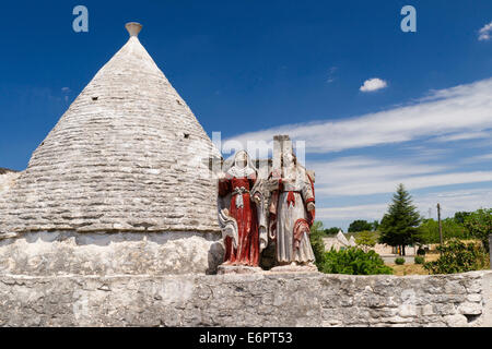Saints, religious piety, Trullo, traditional round cone house, in Martina Franca, Valle d'Itria, Trulli Valley, - Stock Photo